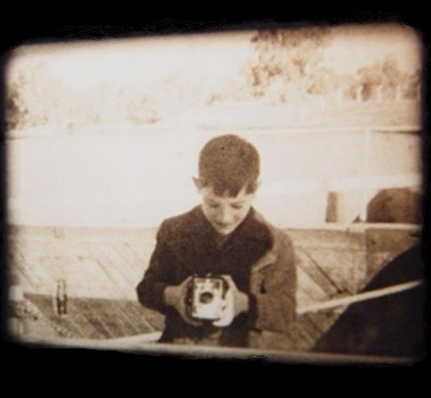a photo found on google images of a boy with a box brownie camera